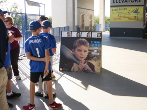Young baseball fans looking at one of our concourse signs (from the Tampa Yankees)